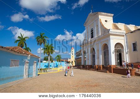Trinidad Cuba - January 29 2017: Plaza Mayor - Principal square of Trinidad. Above the plaza to the north -east stands the Church of the Holy Trinity. One of UNESCOs World Heritage sites since 1988. Sancti Spiritus Province Cuba.
