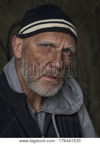 Close up portrait image of a mature homeless man