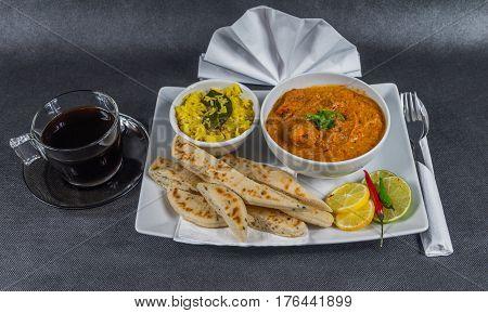 Oriental Indian Set, Chicken Tikka Masala, Naan Bread, White Plate, Black Coffee, Napkin, Peppers