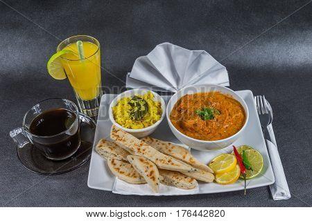 Oriental Indian Set, Chicken Tikka Masala, Naan Bread, White Plate, Black Coffee, Orange Juice, Napk