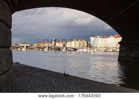 Prague Czech Republic - March 3 2017: View on the Prague panorama under the bridge after rain.The Prague bridges arching over the Vltava River are not only vital connecting links but also valuable works of architecture .