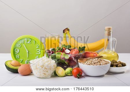 Fresh Salad With Cheese And Tomato, Oatmeal In Plate, Olive