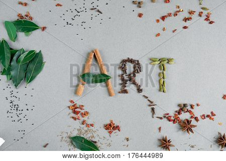 Word Art from green leaves and seasonings. Multicolor paint splash painted word art. White background top view