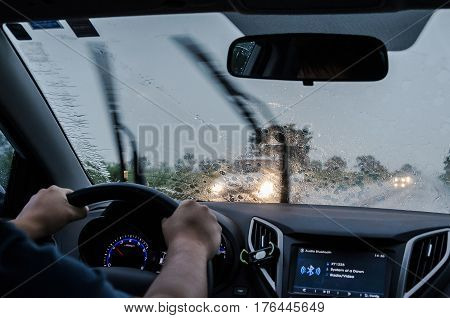 Driving The Car On The Road On A Rainy Day