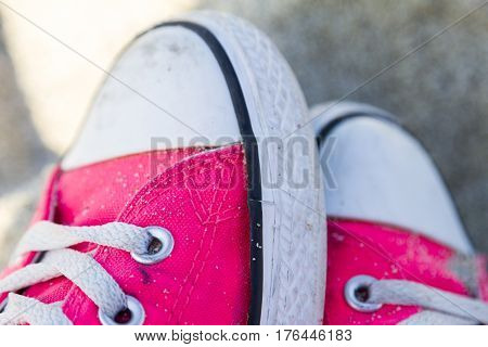 An Old Pair Of Pink Trendy Canvas Shoes.