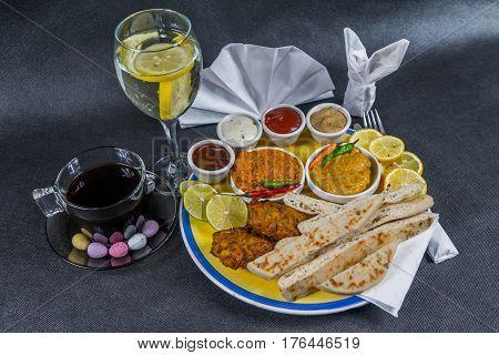 Oriental Indian Set, Chicken Korma, Chicken Tikka Masala, Naan Bread, Onion Bhaji, Plate, Coffee, Wa
