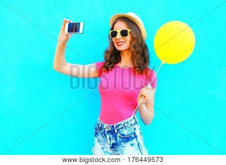 Fashion Pretty Smiling Young Woman Taking Picture Self Portrait On Smartphone With Yellow Air Balloo