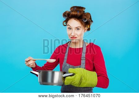 Nice young woman doesn't like smell of homemade meal cooked for family dinner