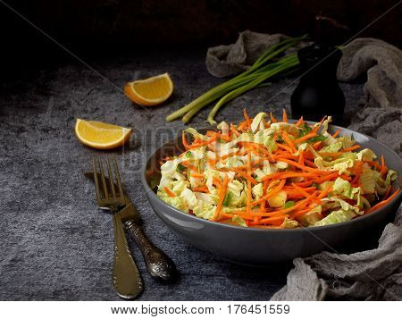 Fresh Vegetables Salad With Cabbage, Carrot, Parsley On Grey Clay Plate On Dark Background. Cole Sla