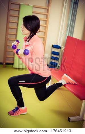 Fitness Woman Exercising With Free Weights