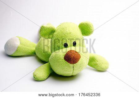 Sad Stuffed green dog Want to die on white