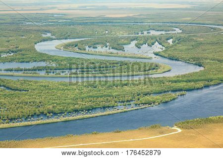 Aerial view river in flooded forest plains during spring.