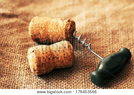 Wooden corks and corkscrew open the bottle object