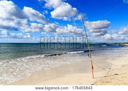 Fishing Rod On Platja Es Trenc Beach Panorama And Mediterranean Sea On Majorca, Spain
