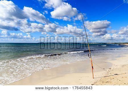 Fishing Rod On Platja Es Trenc Beach Panorama And Mediterranean Sea On Majorca, Spain