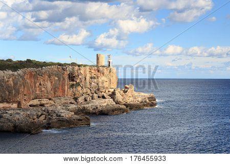 Watchtower Torre d'en Beu and Mediterranean Sea in Cala Figuera Majorca Spain