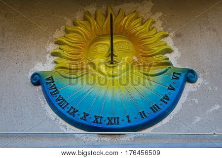Sundial with the Sun symbol and Roman numerals