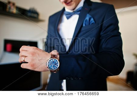Man Wearing Bow Tie Wear Watches On Hand, Morning Of Groom At Wedding Day.
