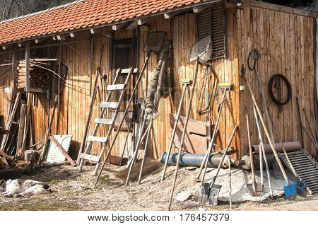 Wooden shed with tools and equipment at fish hatchery in mountain
