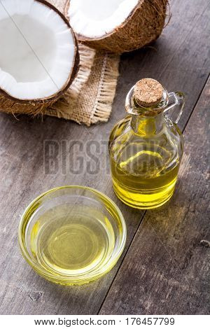 Coconut fruit oil on wooden table background