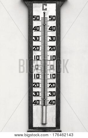 big external thermometer on a wall closeup monochrome tone