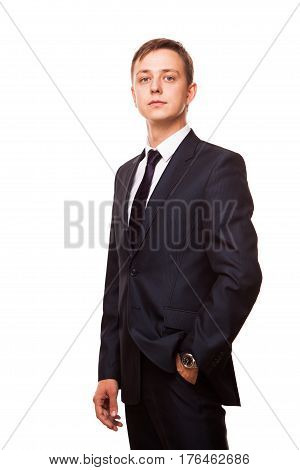 Young handsome businessman in black suit is standing straight, full length portrait isolated on white background.
