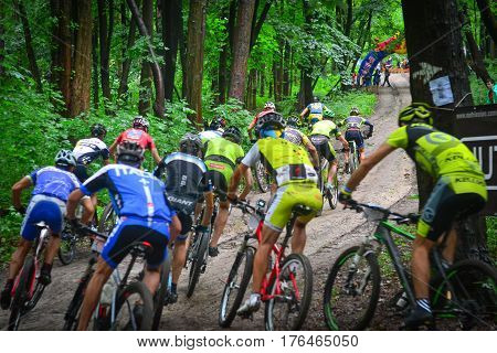 Lviv Ukraine - August 17 2016: Group of MTB cyclists competing in the forest near Lviv in Ukraine at 4th round of amateur xc cup of Ukraine 2016.