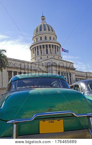 Vintage Car Parked Outside The Capitol Of Havana, Cuba.