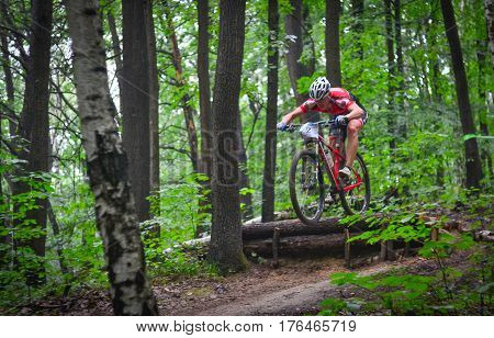 Lviv Ukraine - August 17 2016: MTB cyclist O. Todorchak competing in the forest near Lviv in Ukraine at 4th round of amateur xc cup of Ukraine 2016.
