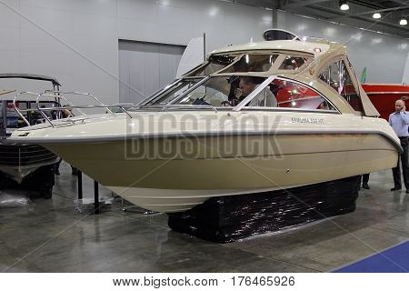 MOSCOW - MARCH 09 2017: Boat Enigma 590 HT for 10 International boat show in Moscow. Russia.