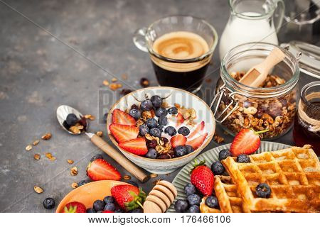 Breakfast Table With Cereal Granola, Milk, Fresh Berries, Coffee And Waffles