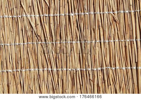 Mat woven from reeds. Natural material for covering something.