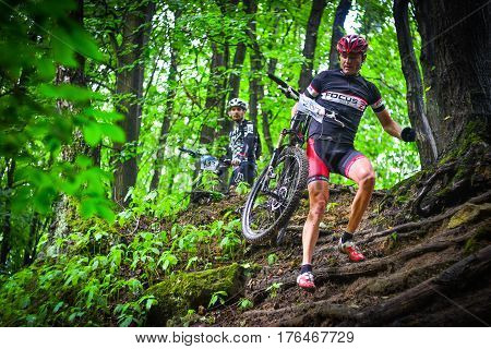 Lviv Ukraine - August 17 2016: MTB cyclist A. Hryn competing in the forest near Lviv in Ukraine at 4th round of amateur xc cup of Ukraine 2016.