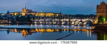 Prague Czech Republic - May 25 2016: Night view over river Vltava to Charles bridge and Prague castle with copy space in clear sky
