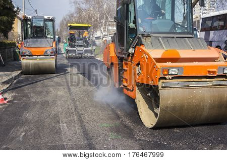 Road roller vibration machines compacting fresh asphalt