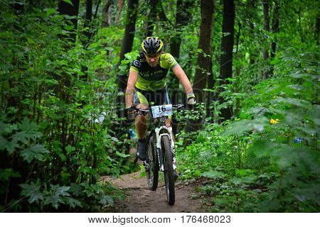 Lviv Ukraine - August 17 2016: MTB cyclist V. Shylyzhynskyi competing in the forest near Lviv in Ukraine at 4th round of amateur xc cup of Ukraine 2016.