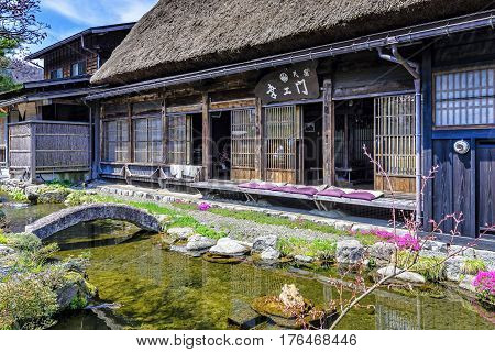 Shirakawa-go, Japan - April 25, 2014: View of Minshuku Koemon exterior in the morning. Minshuku are a budget version of ryokan (traditional Japanese inn), equivalent to a bed and breakfast