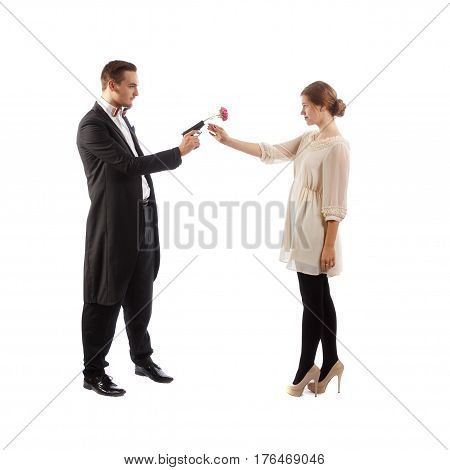 A well-dressed man holding a gun with a rose to a lady