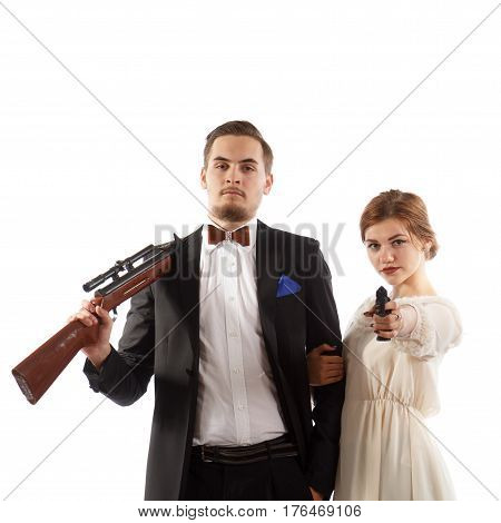 A romantic couple holding a handgun and a rifle