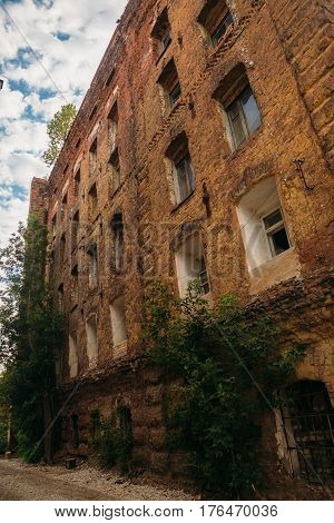 Abandoned after fire historical factory building of red brick - former steam mill of Boberman, Samara, Russia