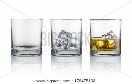 Empty glass glass with ice cubes and glass with whiskey and ice cubes. Isolated on white background