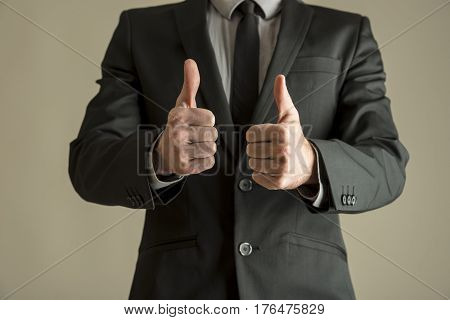 Enthusiastic Businessman Making A Double Thumbs Up