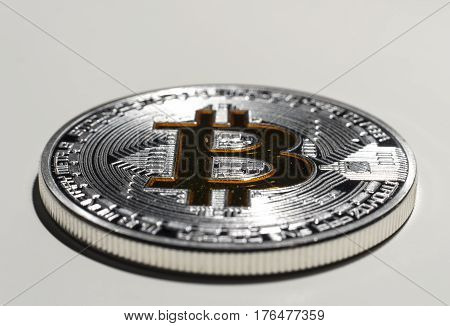 Shining silver and gold metal BTC bitcoin coin on white background.