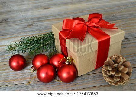 Christmas gift, pinecone, and red Christmas balls