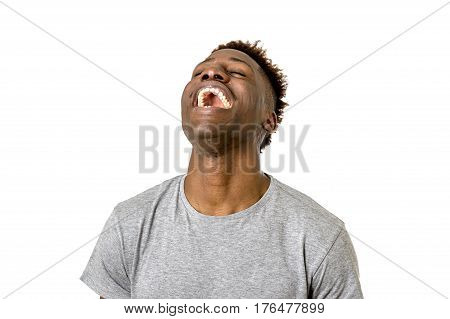 close up portrait of young attractive black african american man laughing happy and excited isolated on white background