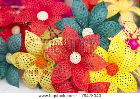 Handcrafted palm mexican color flowers, close up