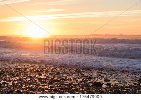 Image of a beautiful sunset and some refelctions during golden hour at a beach in Morocco.