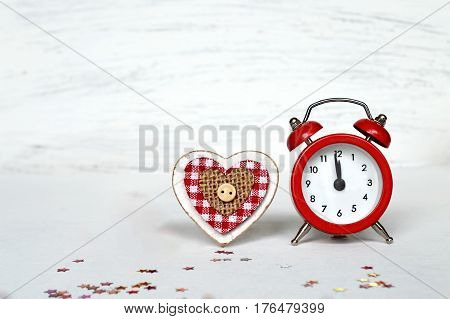 New Year countdown clock and wooden heart on white background