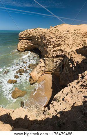 Colorful coastline with a view over a small wild bay  in the Souss-Massa National Park at the Atlantic Ocean in Morooco, Africa.