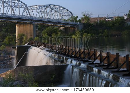 The bridge and dam of the river in Llano, Texas in the morning of a spring day.